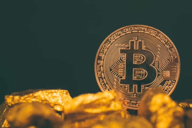 Physical gold Bitcoin with dark-black background